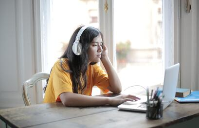 woman-in-yellow-shirt-wearing-white-headphones-3808018
